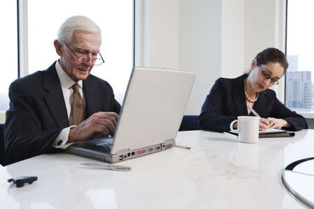 View of businesspeople working in an office. Stock Photo - 5579467