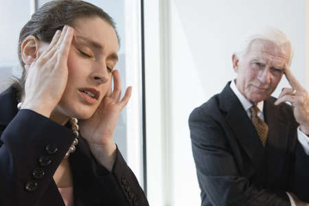 Businesswoman suffering from headache in an office. photo