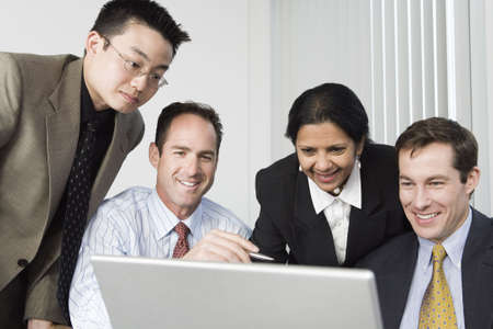 Businesspeople looking at a laptop. photo