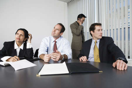 View of businesspeople thinking in an office.