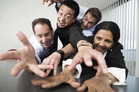 View of businesspeople reaching across a table. Stock Photo