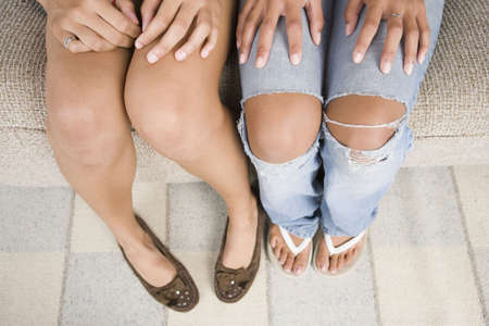 Low section view of two teenage girls photo