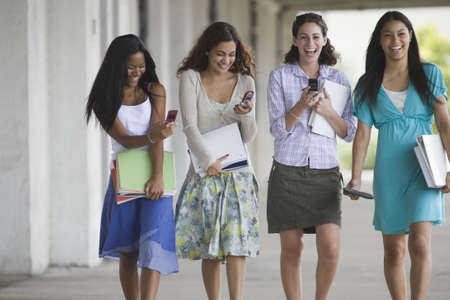 Four teenage girls hanging out in the school campus photo