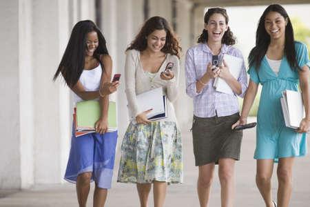 Four teenage walking together Stock Photo