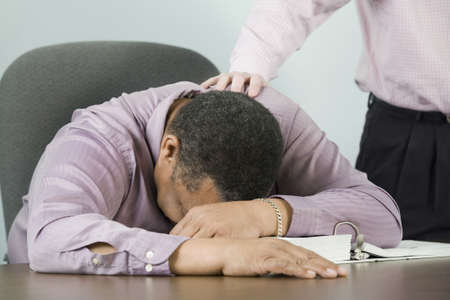 Mid section view of a businessman consoling his colleague Stock Photo
