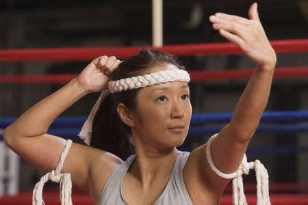 wei: Woman waving during Wei Kru ceremonial martial art dance.