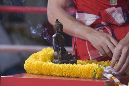 wei: Preparation ceremony for Wei Kru excercise.  Burning incesnse with statute of Buddha. Stock Photo