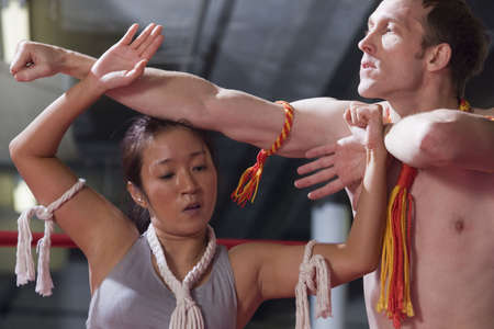 wei: Man and woman in oriental Wei Kru martial art exercise. Stock Photo
