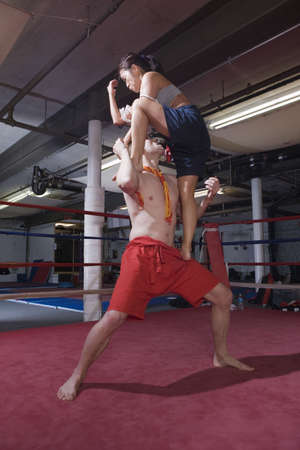 Man overcome by woman in martial art exercise. photo