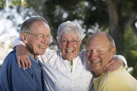 Portrait of senior friends smiling. Horizontally framed shot.