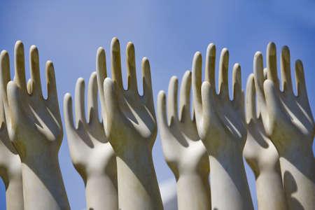 Sculptured hands raised towards the sky. Horizontally framed shot. Stock Photo - 6114798