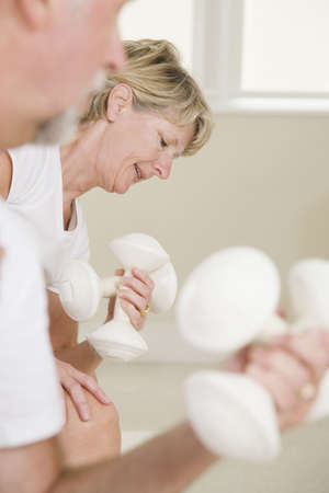 Senior woman exercising with hand weights Stock Photo