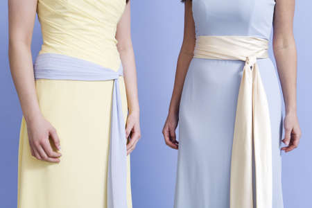 unknown age: Midsection of bridesmaids standing.