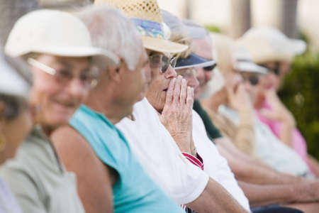 Group of senior people sitting in a row Stock Photo - 6160422