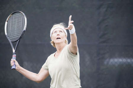 Senior  woman playing tennis photo