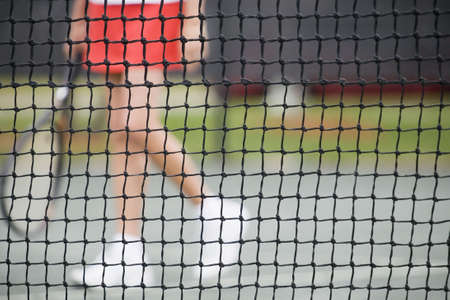Low section view of a senior woman playing tennis photo