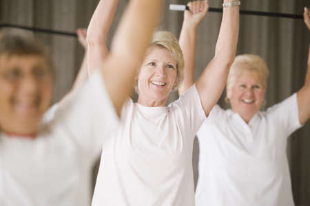 Close-up of a senior woman exercising in an exercise class Stock Photo