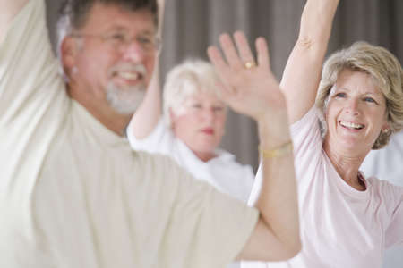 adult class: Close-up of a senior woman and a senior man exercising in an exercise class Stock Photo