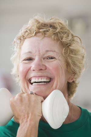 Portrait of a senior woman exercising with a hand weight Stock Photo - 6160351