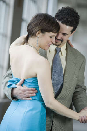 well dressed  holding: Mid adult couple dancing Stock Photo