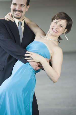 Portrait of a mid adult couple dancing photo