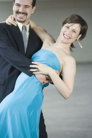 mid adult couple: Portrait of a mid adult couple dancing