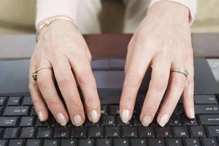 Close up of a mature woman using a laptop. Stock Photo