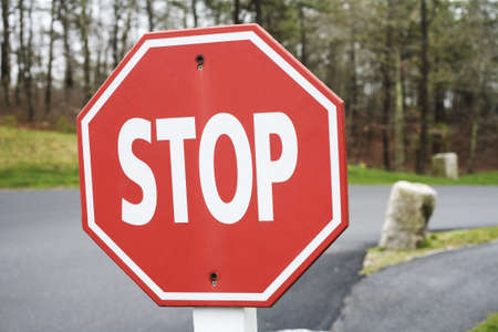 octagonal: Stop sign displayed on the road. Stock Photo