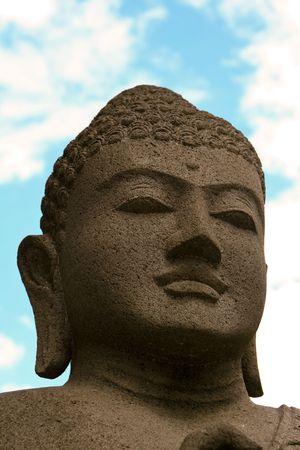 A praying Buddha (head detail) Stock Photo