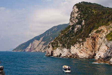 The Cinque Terre is a rugged portion of coast on the Italian Riviera. It is in the Liguria region of Italy, to the west of the city of La Spezia. Stock Photo