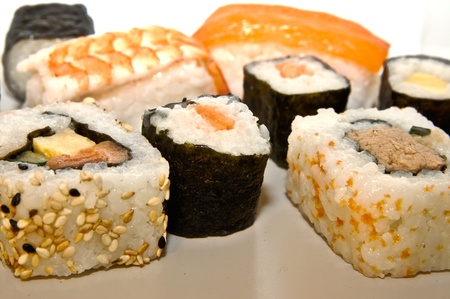 Sushi is a Japanese dish consisting of cooked vinegared rice which is commonly topped with other ingredients, such as fish or other seafood Stock Photo