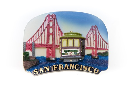 A magnet of the famous city, showing the Golden Gate and a cable car