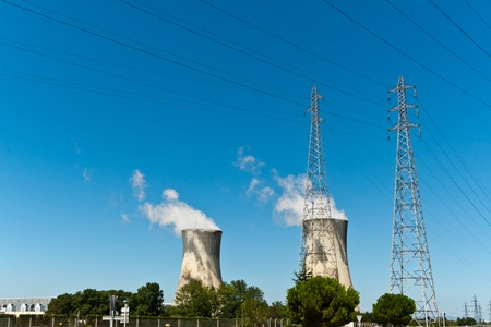 Cooling towers are heat removal devices used to transfer process waste heat to the atmosphere. Stock Photo