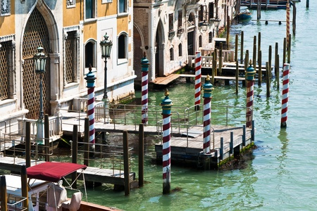 Gondola mooring poles in Venice painted with red and white spiral stripes