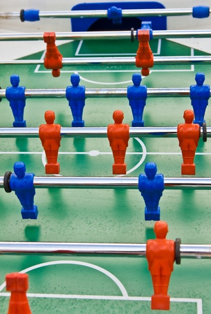 foosball: The old toy with blue and red players Stock Photo