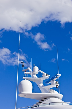 Navigation equipment of a big white motor yacht.