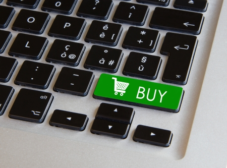 Modern black keyboard with a green cart button Stock Photo