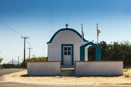 A simple Greek chapel on a sunny day Stock Photo