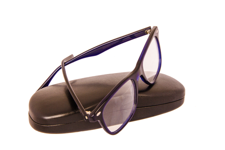 Close-up of eyeglasses with case on a white background