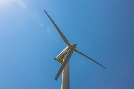 Wind energy concept. Electricity generating windmill. Stock Photo