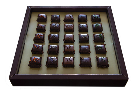 Variation of chocolate candy in the box isolated on white