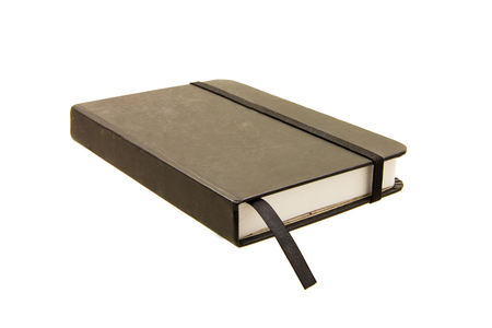 Classic diary closed with elastic band over white