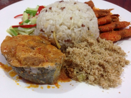 kelantan: Nasi Dagang Steamed rice in coconut with fish curry and other sides