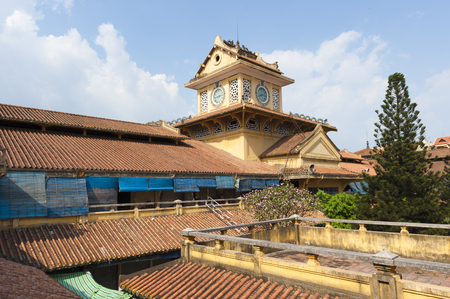 clocktower: Vietnamese architectural rooftop and clocktower of the ancient Cholon