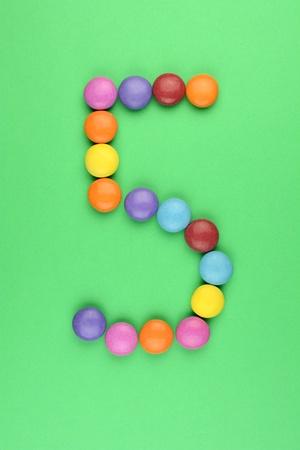 ferrous: number 5 consists of ferrous bonbons Stock Photo