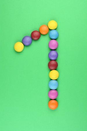 ferrous: The number 1 consists of ferrous bonbons Stock Photo