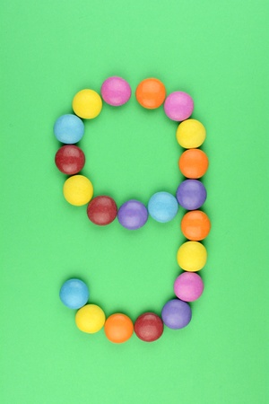 ferrous: Number 9 consists of ferrous bonbons Stock Photo