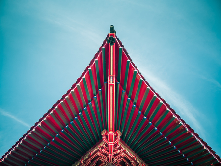 The eaves of a temple with blue sky background