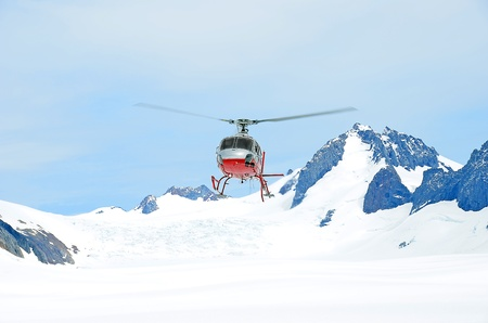 Helicopter taking off in the snow