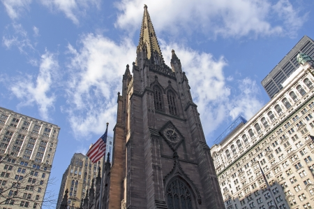 Old church in New York City, rounded by big buildings